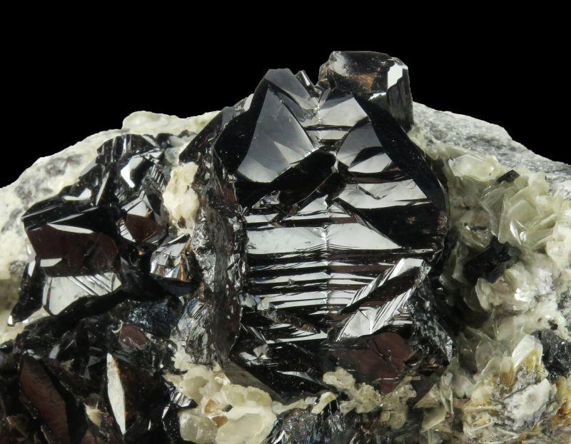 Cassiterite twinned xls on Muscovite (fine!)