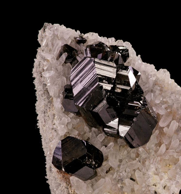 Cassiterite on Quartz (excellent) Ed David Coll.